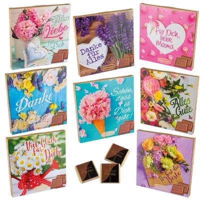 Scatole con cioccolatini, fiori